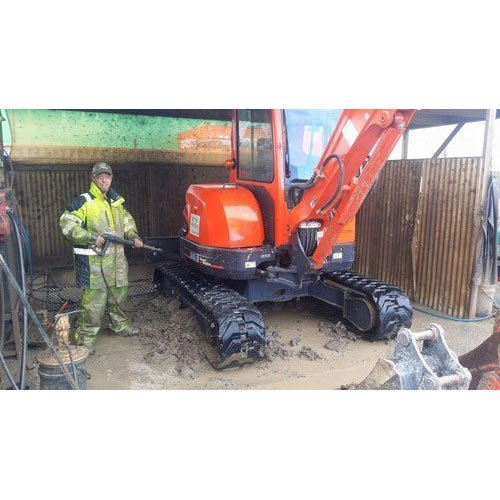 Really Dirty excavator being cleaned
